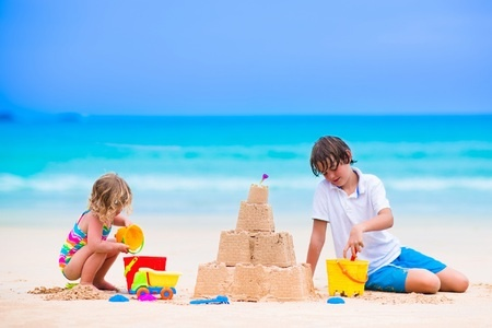 Kids Building a Sandcastle